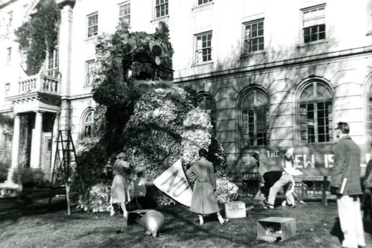 photo of students in front of the Nursing building preparing for a Homecoming event in 1958