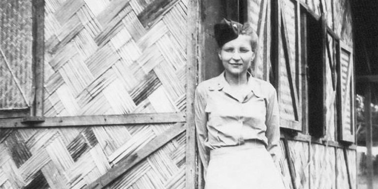 "photo of Signe Skott in front of her ""basha,""while serving overseas in Chabua, India, during WWII."