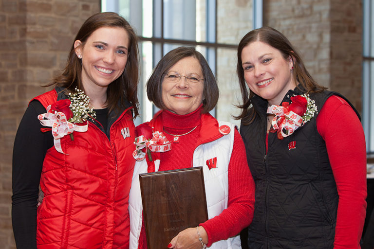 photo of an NAO Distinguished Alumni Award honoree with family, 2016