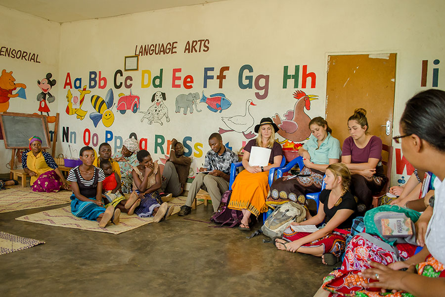 UW Nursing Students talk with parents in Malawi about healthcare.