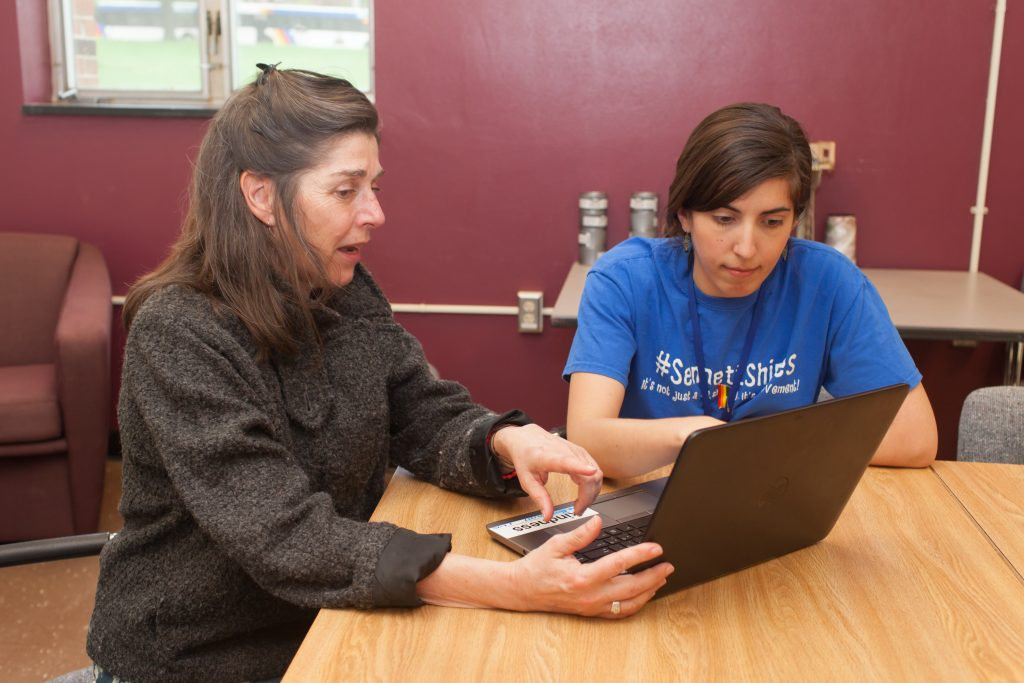 School nurses confer at work in middle school