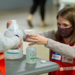BSN students prepare hand sanitizer at the School of Nursing COVID vaccination clinic