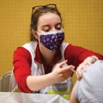 BSN student administers COVID-19 vaccination
