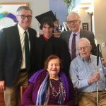 family celebrates graduation